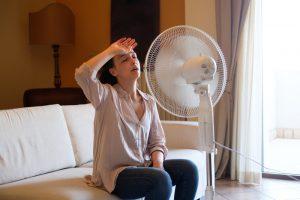 woman-sitting-in-front-of-ceiling-fan